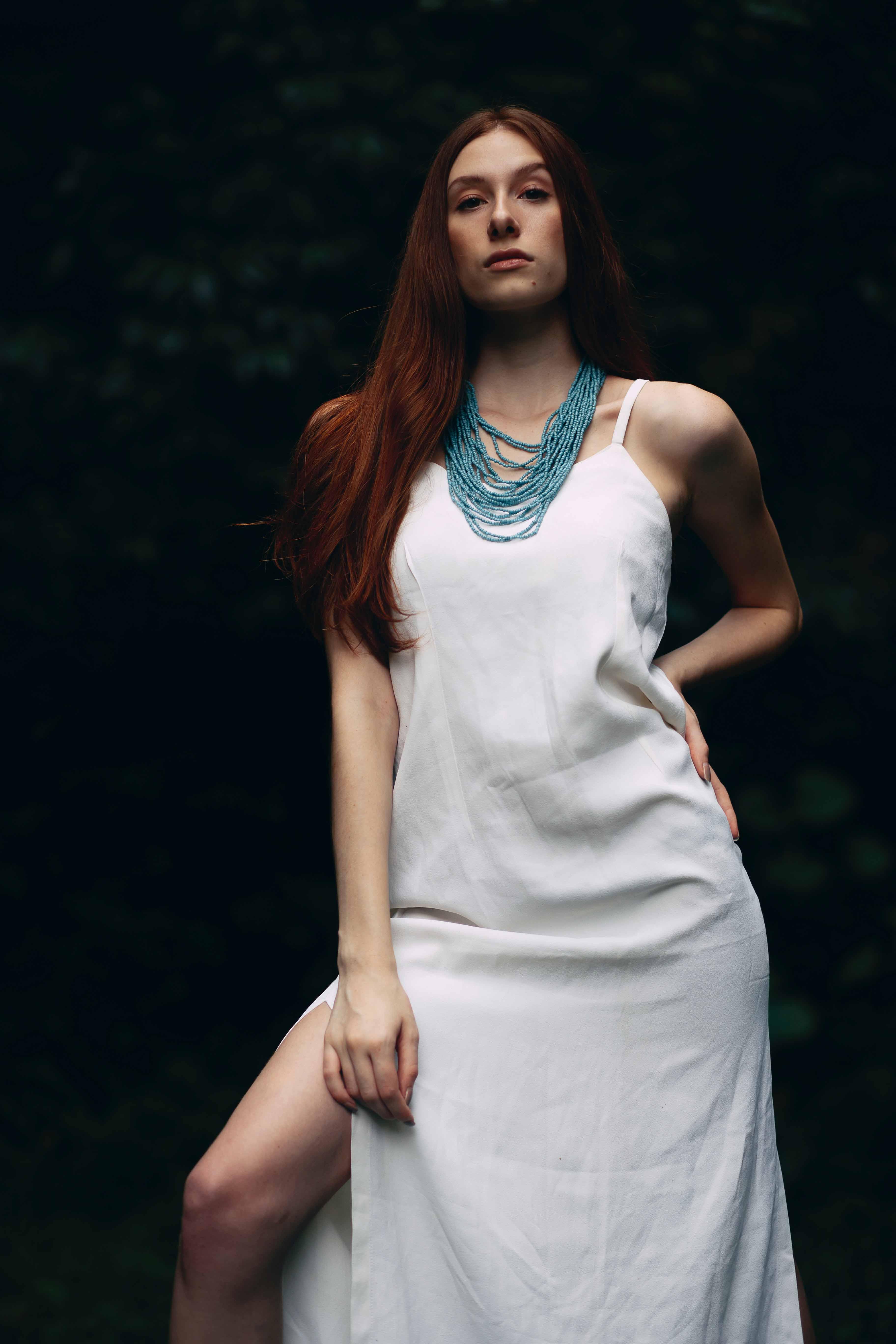 Kennington escorts - hot redhead in white skirt