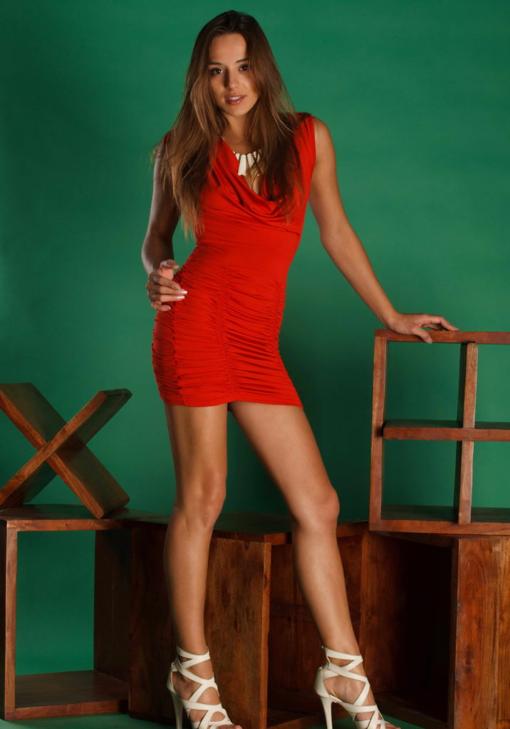 Classy Young Brunette In Red Dress